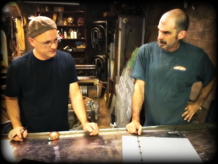 Doug (left) and Sean confer over a piece getting cut for production.