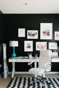 Using colored art with white frames in this black and white room is a modern spin on this tried and true method!